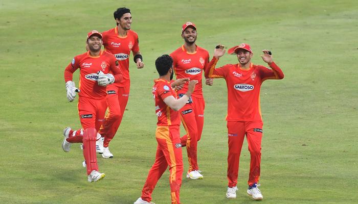 Islamabad United players celebrate after dismissing a Peshawar Zalmi batsman at the Sheikh Zayed Stadium in Abu Dhabi. Photo: PSL
