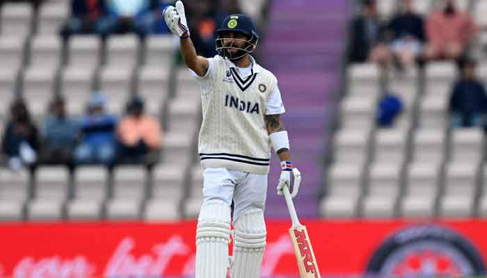Indias Virat Kohli reacts on the second day of the ICC World Test Championship Final between New Zealand and India at the Ageas Bowl in Southampton, southwest England on June 19, 2021. — AFP