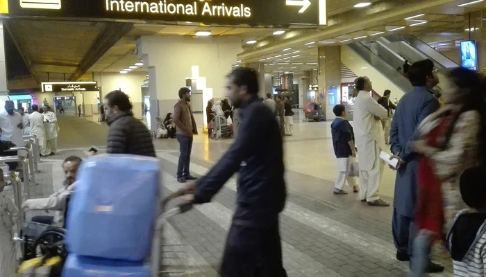 Passengers walk after their arrival at the Jinnah International Airport in Karachi on January 31, 2020. — AFP/File