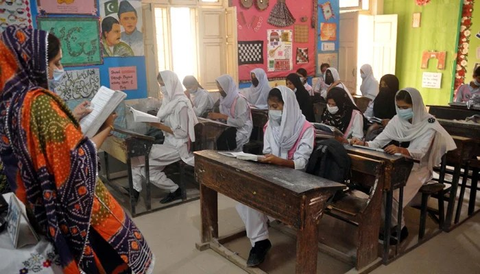 Students studying while following SOPs at a school in Hyderabad, on June 15, 2021. — PPI/File