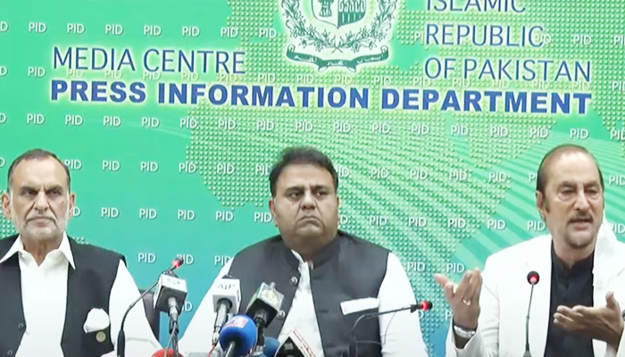 Railways Minister Azam Khan Swati (L) Information and Broadcasting Minister Fawad Chaudhry (C) and Adviser to the Prime Minister for Parliamentary Affairs Babar Awan hold a press conference in Islamabad on Friday, September 10, 2021. — PID