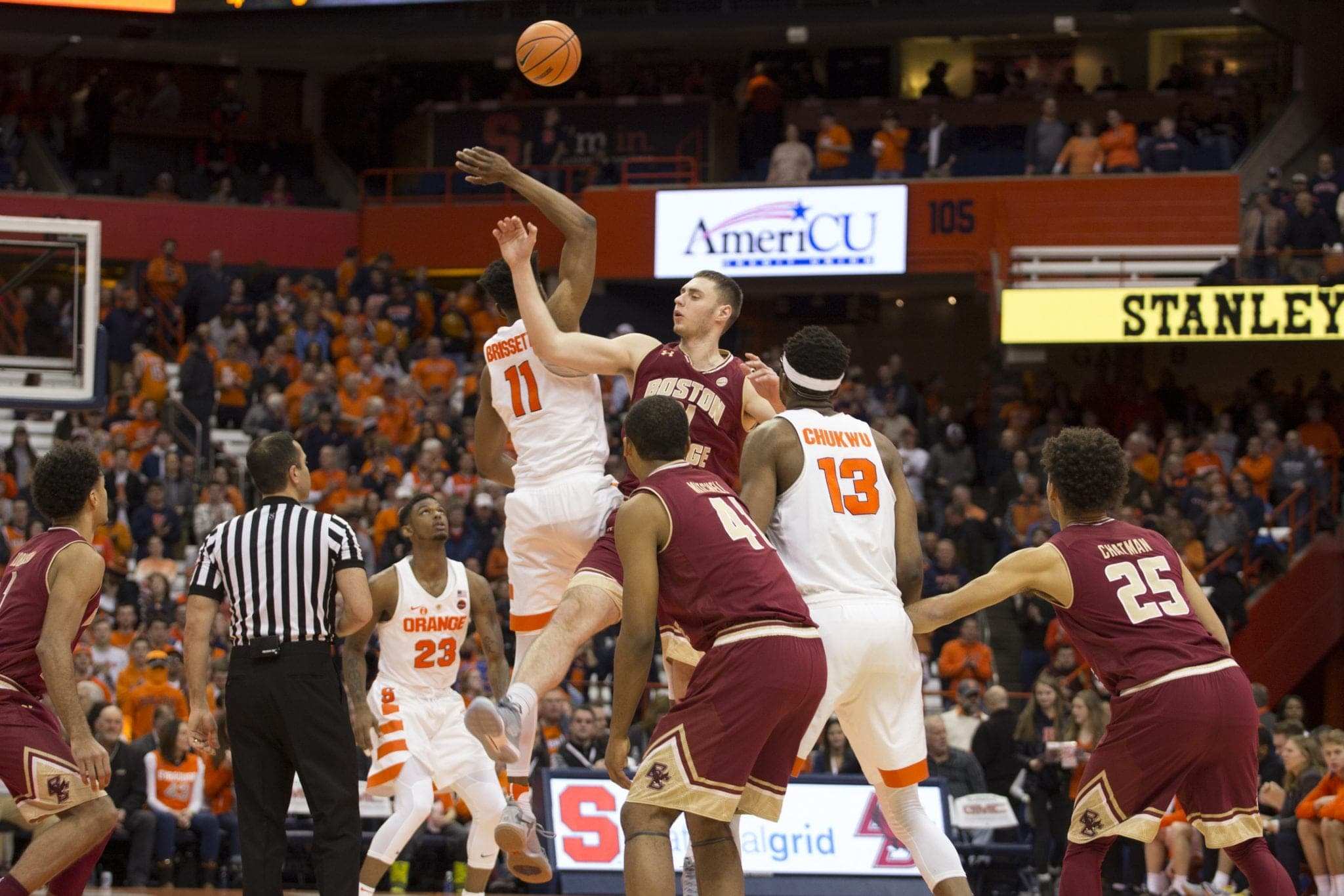 Syracuse and Boston College fight over the Jump Ball.