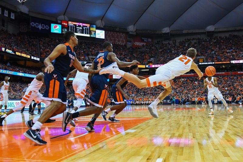 Men's basketball player throws the ball