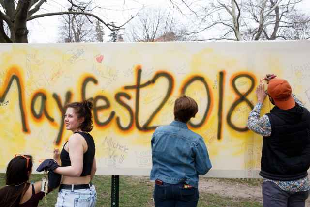 Students signing banner at Mayfest