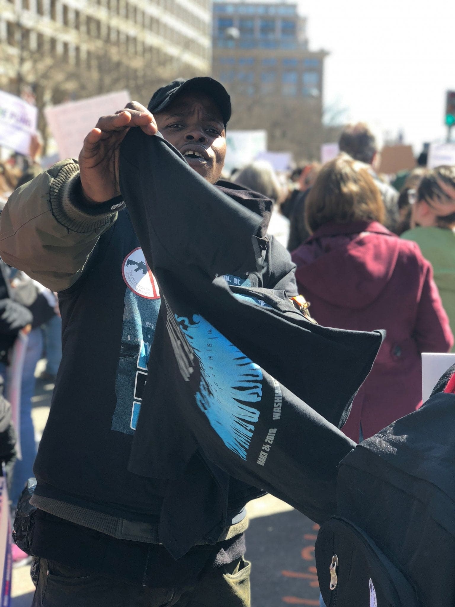A vendor sells t-shirts during march