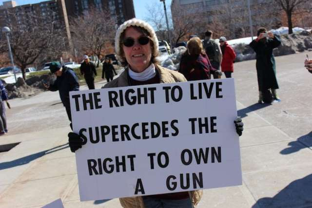 March for Our Lives - Syracuse: Barbara Kamerance, from Oswego County, held her sign an hour before the march.