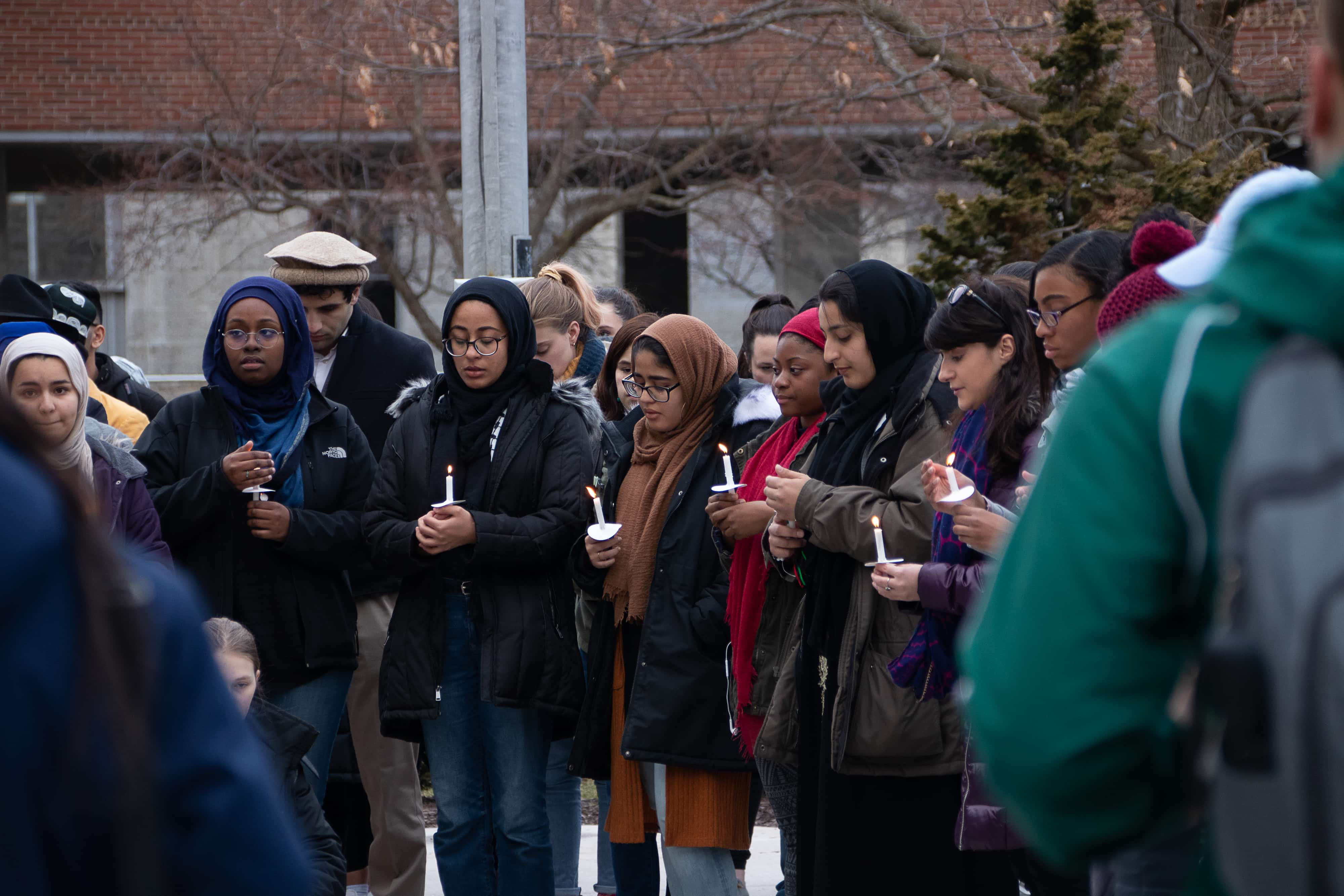 Outside Hendricks Chapel on Tuesday, Syracuse students take a moment of silence to remember the 50 people killed in mosque shootings in Christchurch, New Zealand.