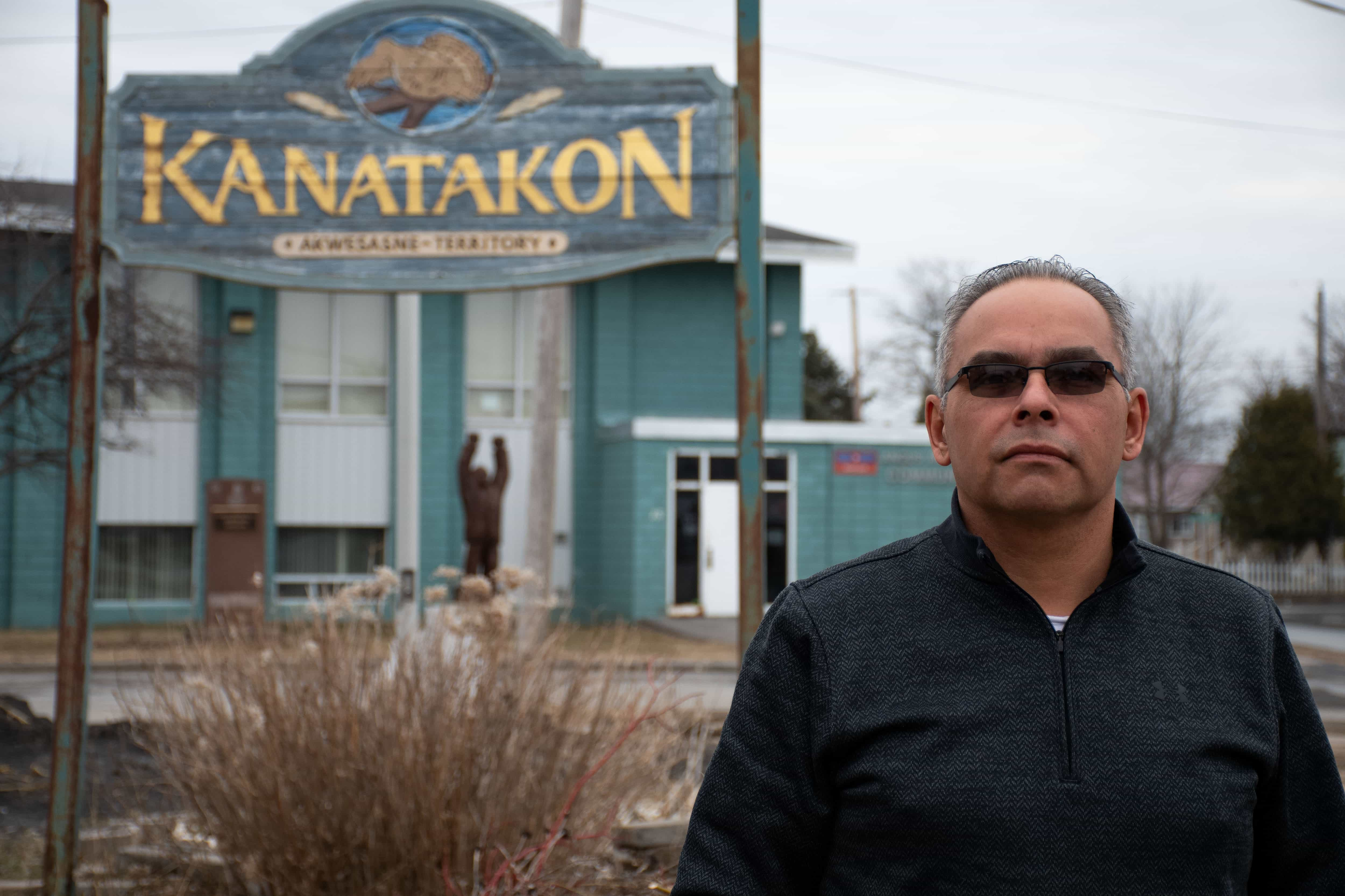 Darryl Lazore, a chief of the Mohawk Council of Akwesasne, stands on the unofficial border between the Canadian and American Akwesasne border. The only sign of the sudden switch between territories is the change from miles to kilometers on speed limit signs along the road.