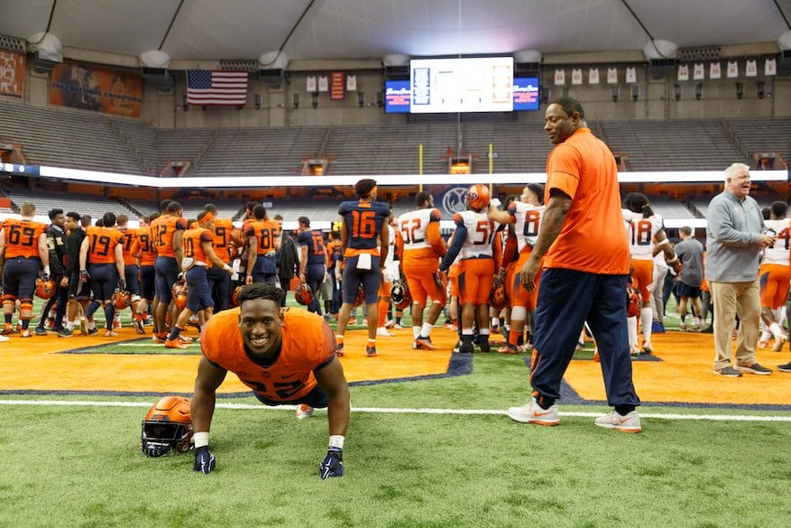 Syracuse Football - Spring 2018 Showcase - April 13, 2018 - Player pushup while Coach Dino Babers looks on