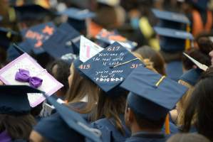 "Graduation cap reads ""Welcome to the real world. It sucks. You're gonna love it."""