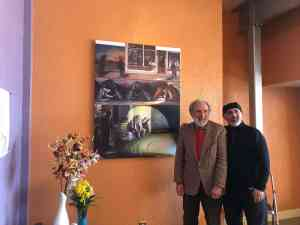 John Tumino, founder of In my Father's Kitchen, (right) stands with Jerome Witkin (left) next to his painting.