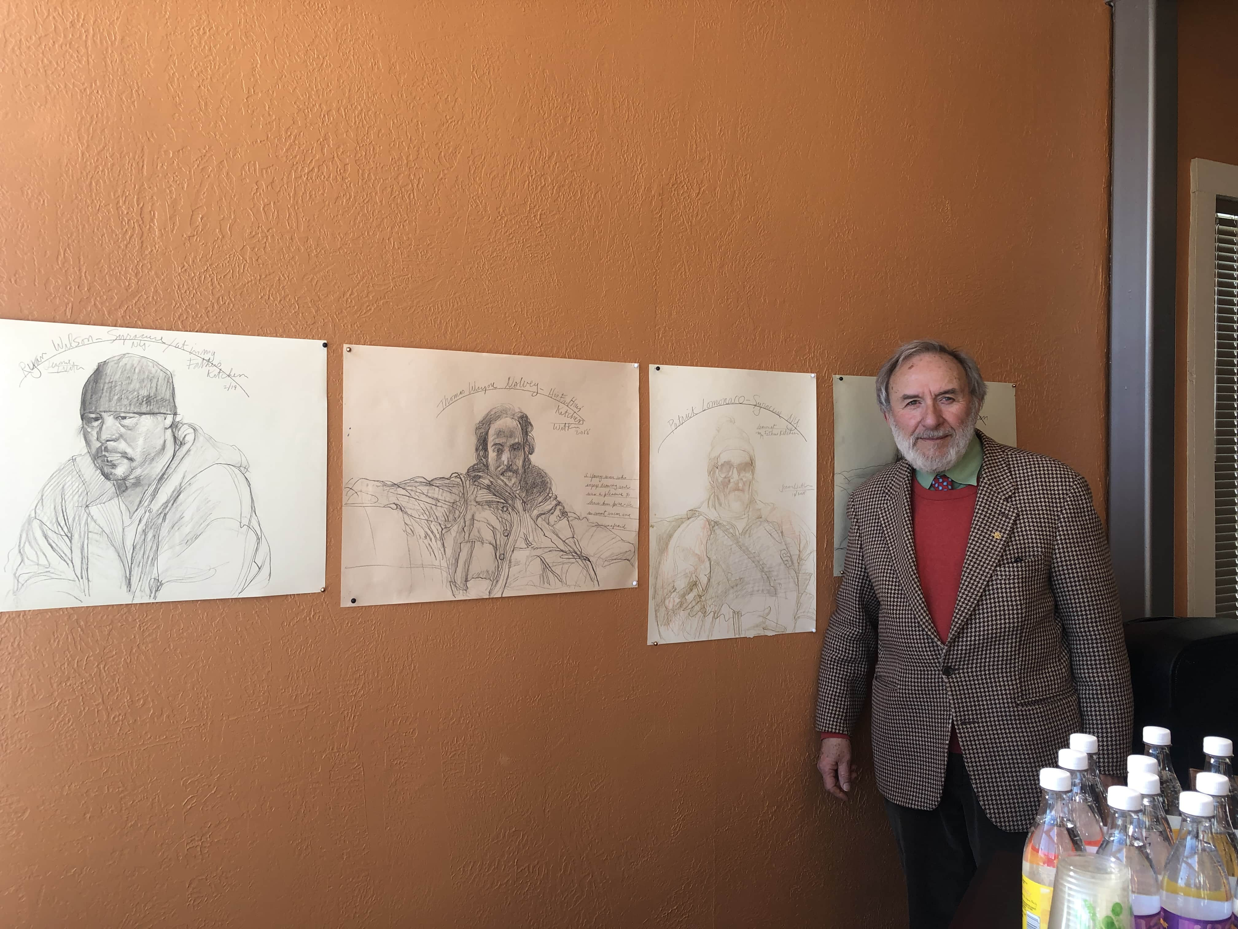 Former SU art professor Jerome Witkin next to his painting.