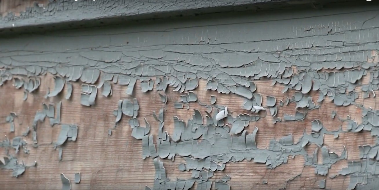 Lead paint peeling off a Syracuse house, posing a potential risk of lead poisoning