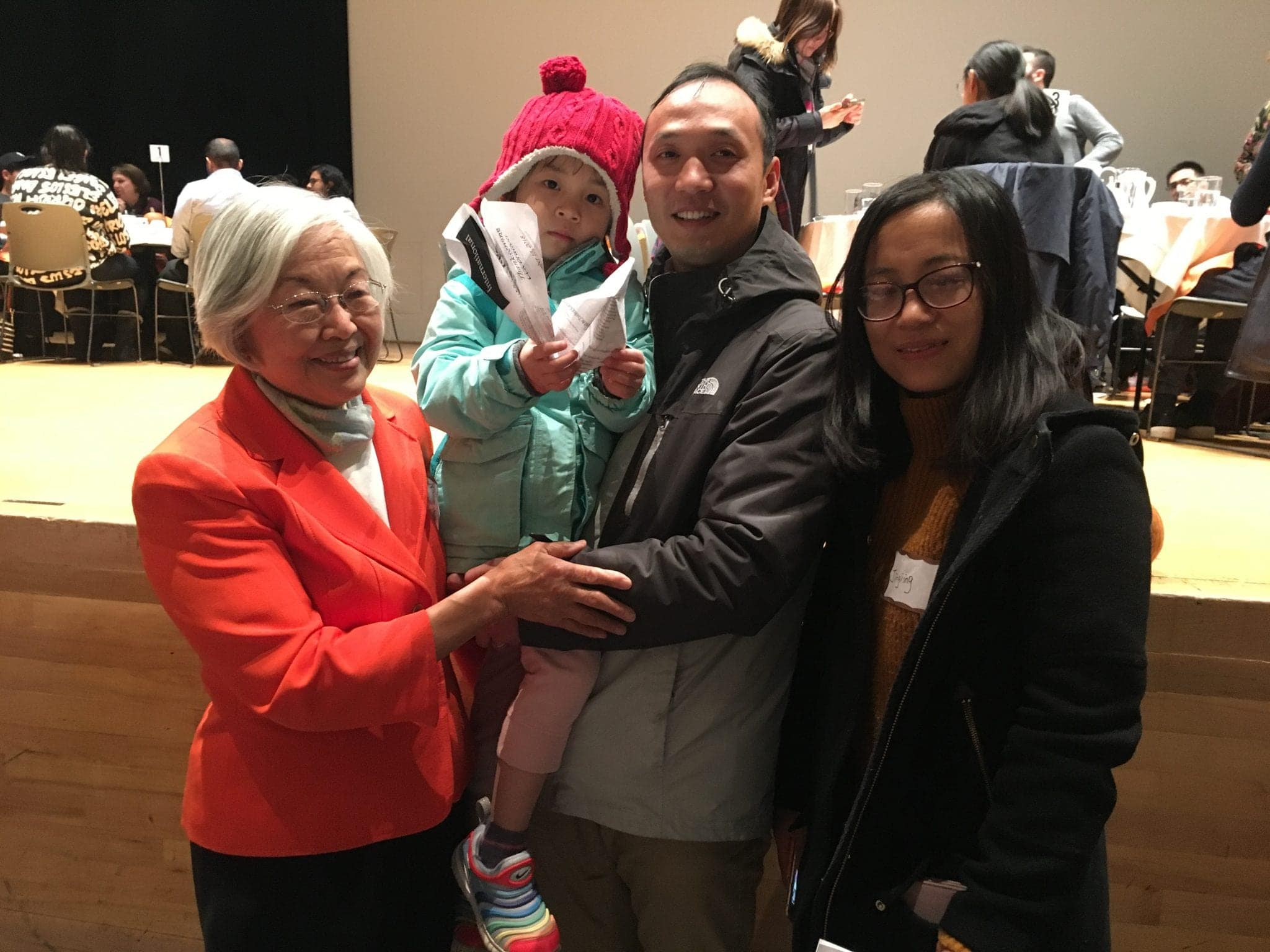Ruth Chen meets with the family of a Syracuse University student at the 34th International Thanksgiving Dinner on Nov. 15, 2018.