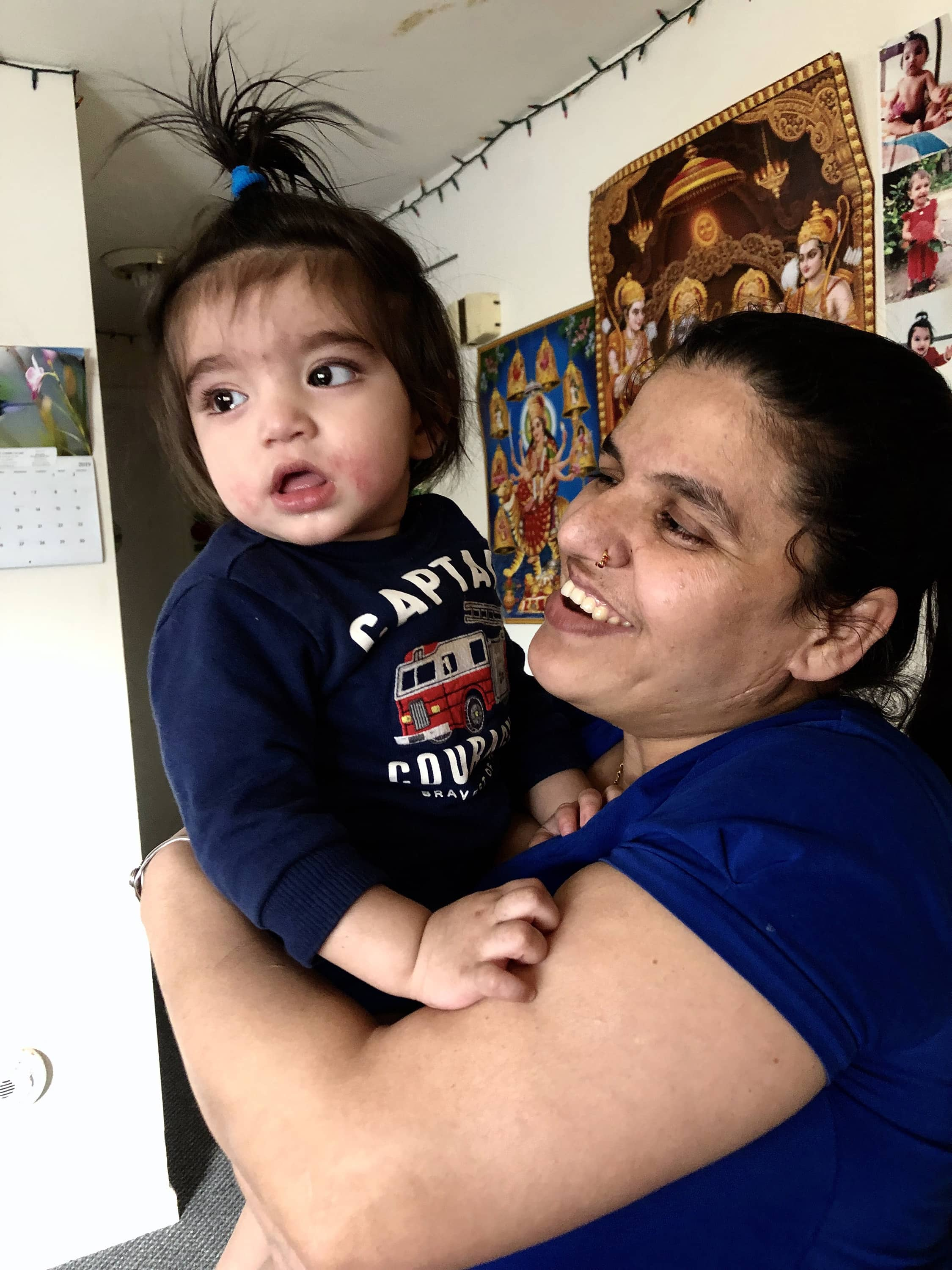 Manika Gautam with her son Ushan in her home in Syracuse.
