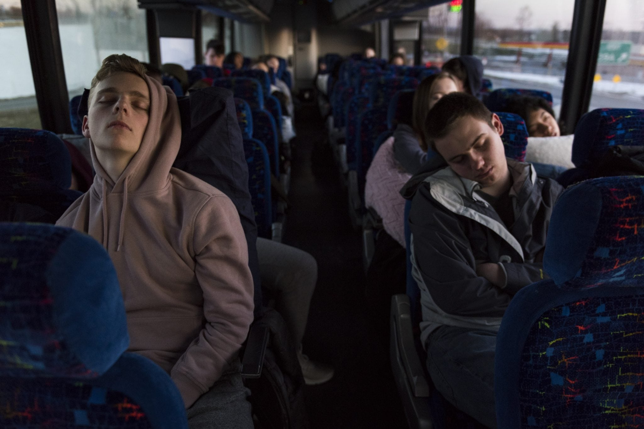 Syracuse University students take a quick nap on the final stretch of the trip on their way to Washington DC for the March for Our Lives rally.