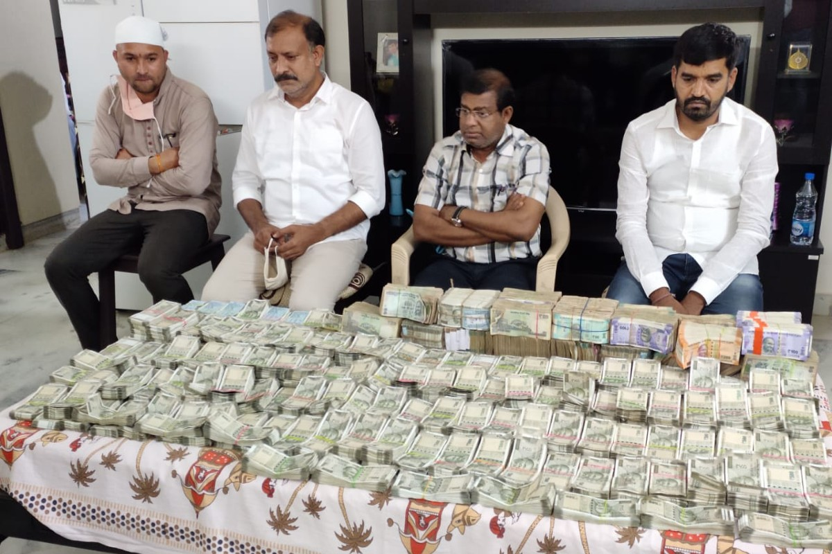 Watch: Bundles of cash, almost Rs 1 crore bribe seized from Telangana tehsildar | The News Minute