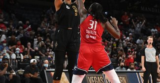 Aces' Liz Cambage takes a shot over Mystics' Tina Charles. Photo via Twitter, @LVAces.