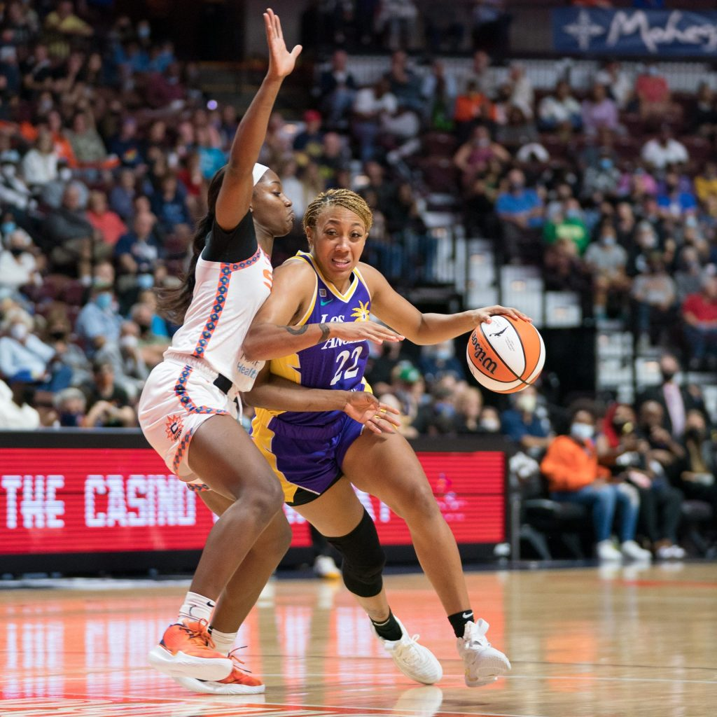 Los Angeles Sparks guard Arella Guirantes (22) drives to the basket as Connecticut Sun guard Kaila Charles (3) defends