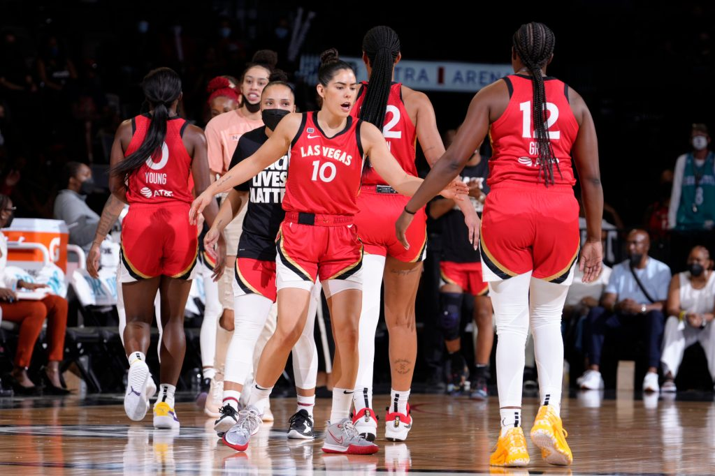 LAS VEGAS, NV - SEPTEMBER 2: Kelsey Plum #10 of the Las Vegas Aces high fives her teammates during the game against the Chicago Sky on September 2, 2021 at  Michelob ULTRA Arena in Las Vegas, Nevada. Copyright 2021 NBAE (Photo by Jeff Bottari/NBAE via Getty Images)