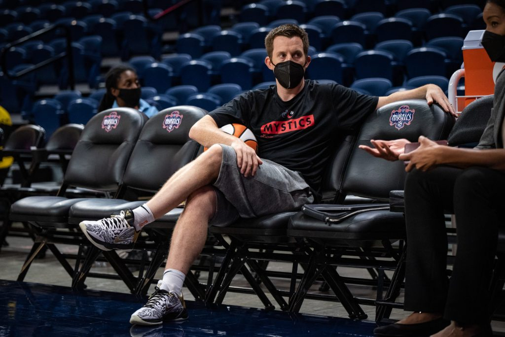 Eric Thibault, now the Washington Mystics' acting head coach, sits on the bench before a game against the Los Angeles Sparks on Aug. 24, 2021. (Photo credit: Domenic Allegra)