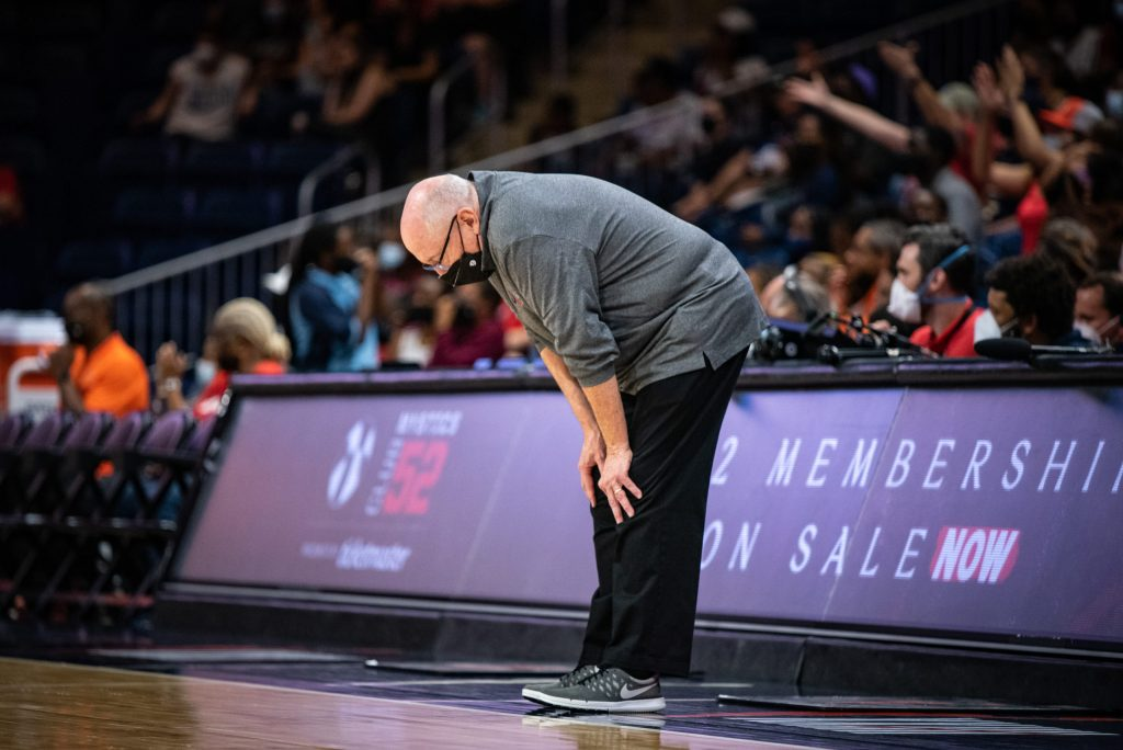 Washington Mystics head coach and general manager Mike Thibault puts his hands on his knees during a game against the Connecticut Sun on Aug. 31, 2021. (Photo credit: Domenic Allegra)