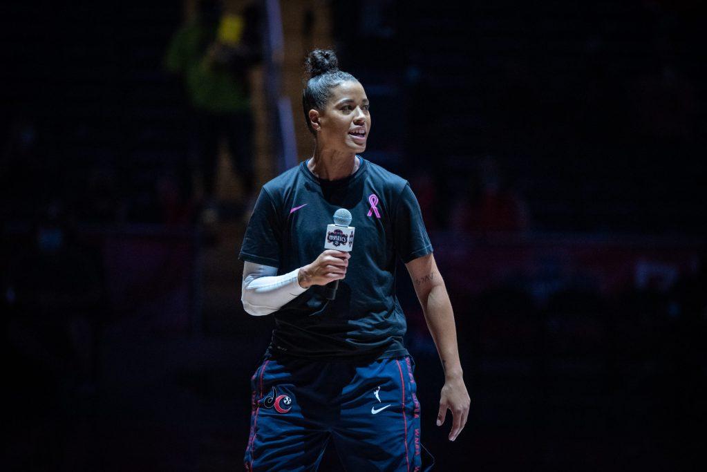 Washington Mystics point guard Natasha Cloud addresses the crowd before the team's Fan Appreciation Night game against the Minnesota Lynx on Sept. 19, 2021. (Photo credit: Domenic Allegra)