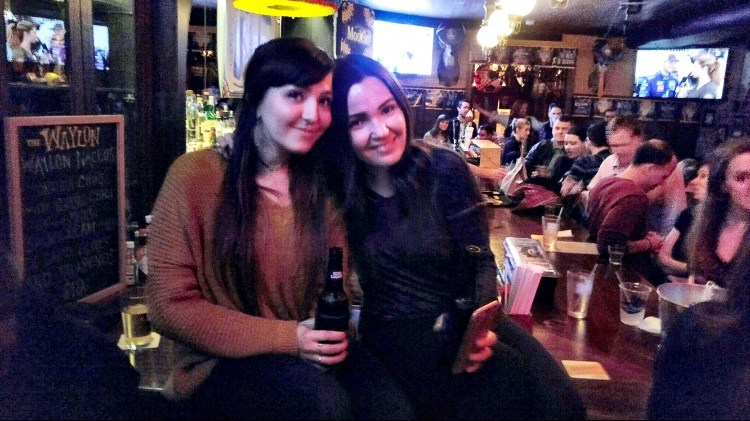 girls at crowded country bar in new york
