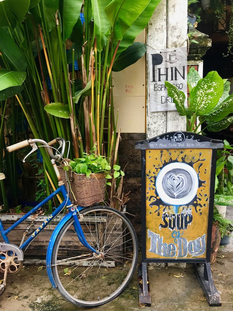 bike and coffee sign outside cafe