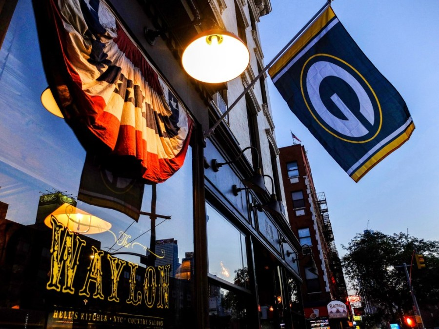 green bay packers flag in front of bar