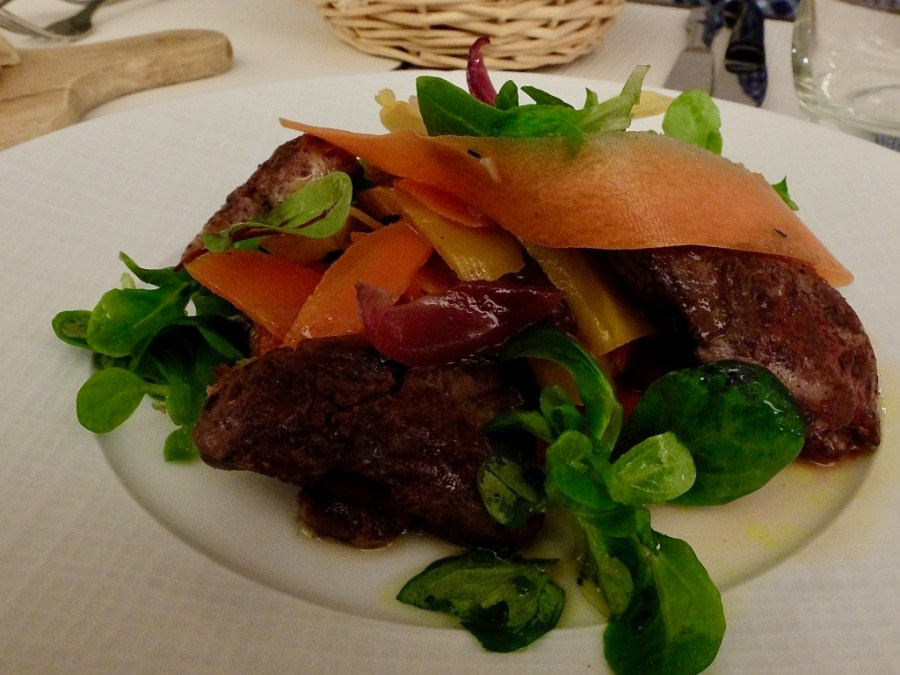 Seared Chicken Liver Salad with carrots on a plate