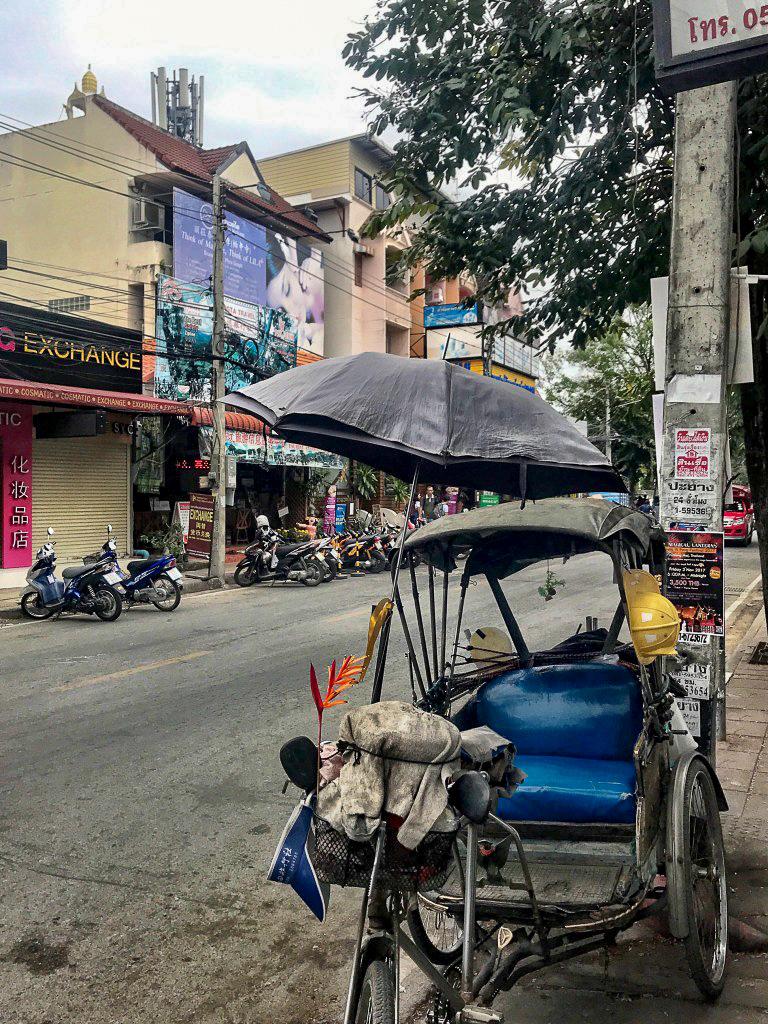 tuk tuk parked on street of chiang mai