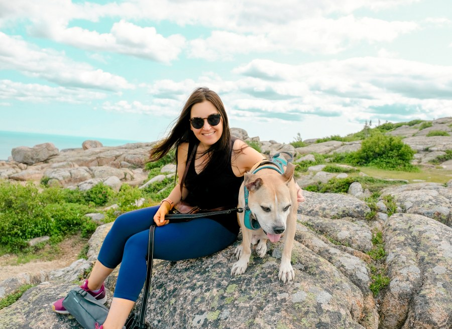 woman and dog on mountain