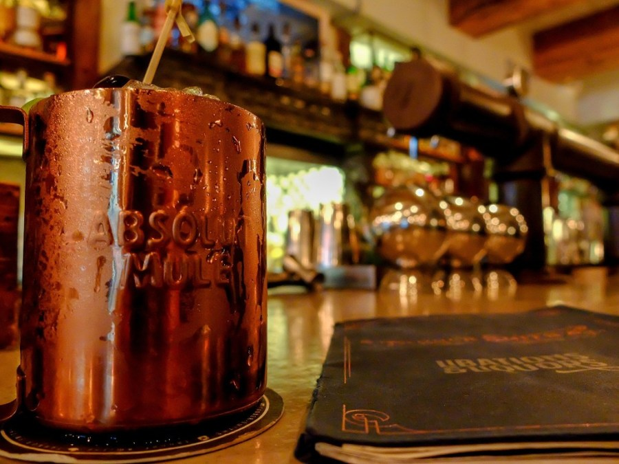 copper mug on bar with menu