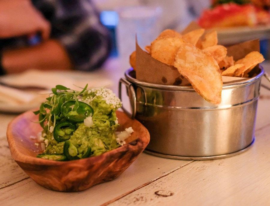 Guacamole and Chip on table at Citrus & Salt