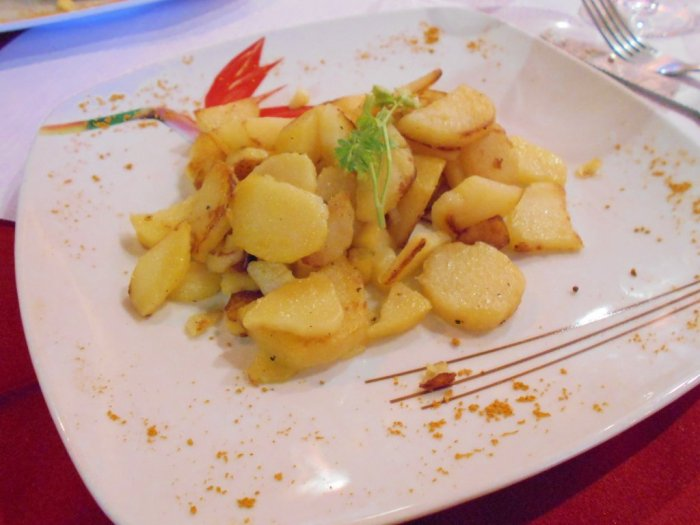 Roasted potatoes at Chez Raymonde - Le Vieux Mazot Restaurant, Evolène, Switzerland