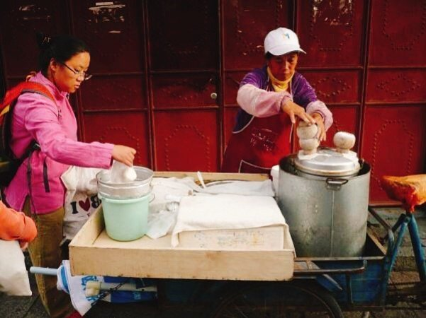Making cakes from the local millet - Living The China Study