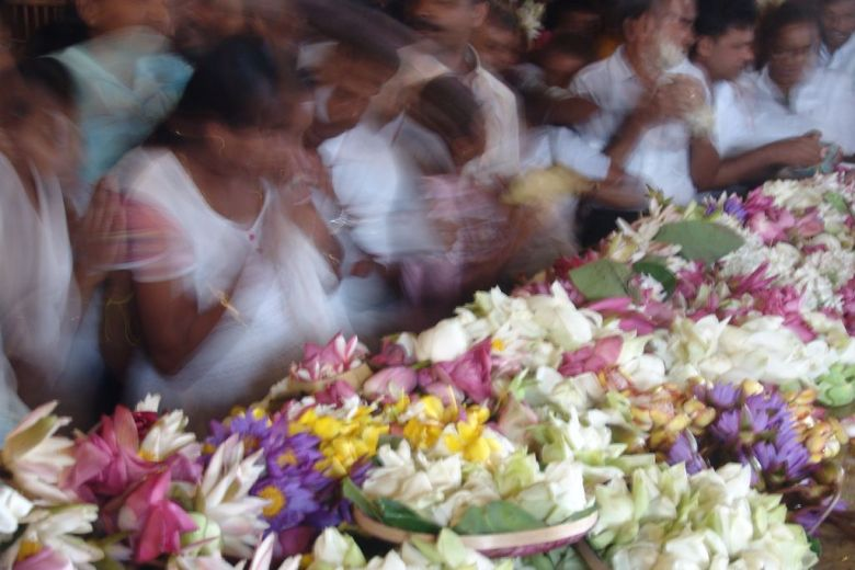 Buddhists praying in Kandy Sri Lanka