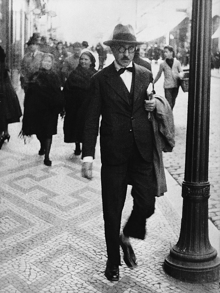 Fernando Pessoa wearing his signature dark-rimmed glasses