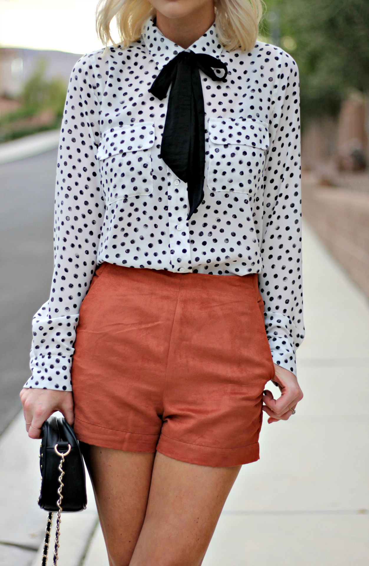 df37d40e8e36 suede-shorts-polka-dot-shirt-bow-blouse-studded-purse-lindsey-simon -the-nomis-niche-las-vegas-fashion-blogger-beauty-blogger-5