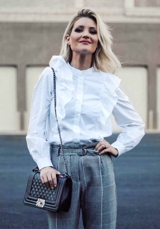 plaid pants, plaid trend, Chanel bag, ruffle blouse, the noms niche, fashion, style, street style, ootd, outfit Inspo, outfit inspiration, how to wear plaid, ways to wear plaid, fall outfit Inspo, fall fashion, lindsey Simon, Las Vegas blogger, Las Vegas fashion blogger, blond hair, bright blonde, studded heels,