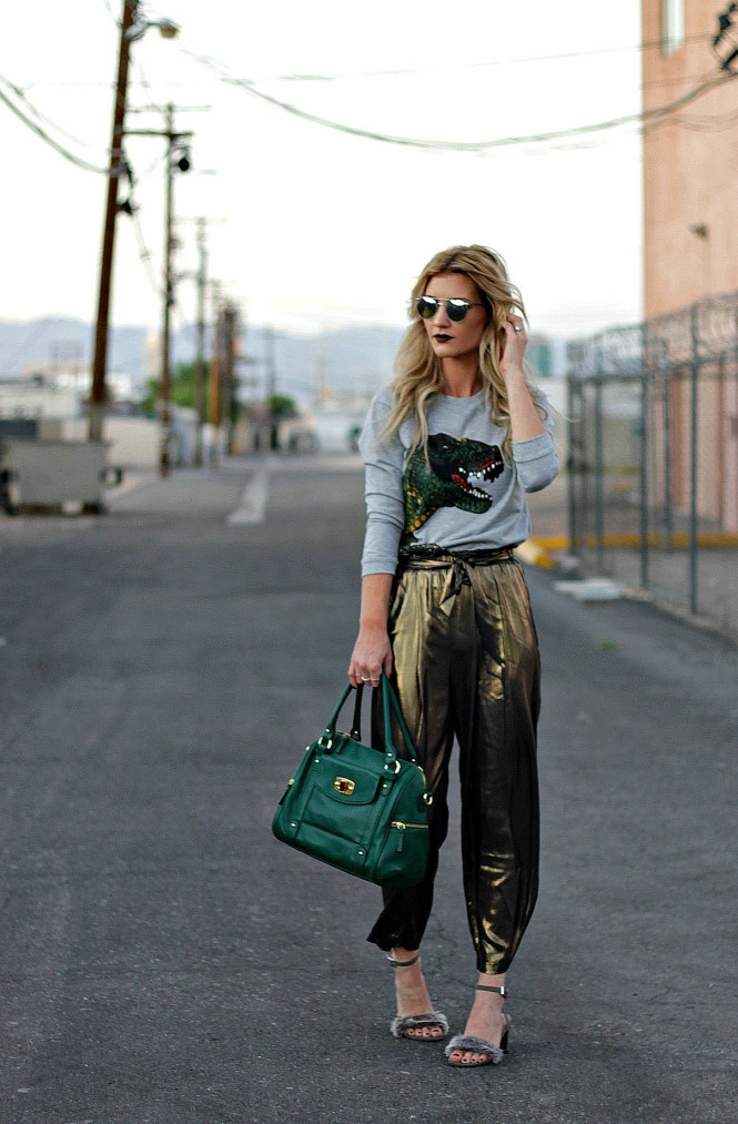 gold pants, harem pants, dinosaur, dino, sweatshirt, sweater, t-rex, green bag, bowler bag, furry heels, fuzzy heels, fall style, date night style, work appropriate, randolf engineering, sunglasses, Las Vegas, fashion blogger, street style, Charles David, shein, budget friendly, fashion, Lindsey Simon, The Noms Niche