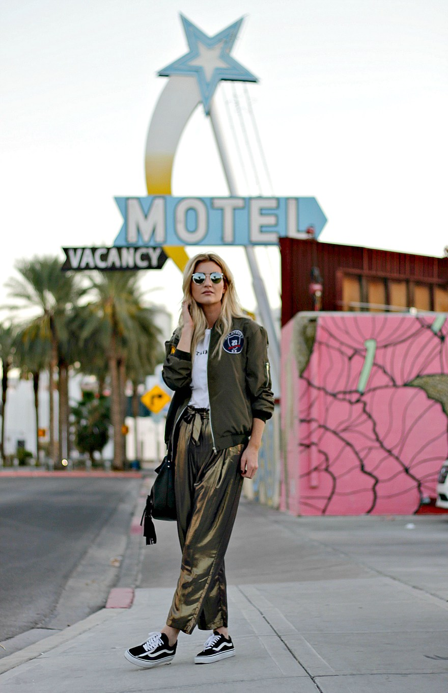 gold pants, gold harem pants, vans, vans oldskool, Las Vegas, las vegas blogger, fashion blogger, street style, edgy fall outfit, edgy summer outfit, edgy outfit, bucket bag, blonde, aviator sunglasses, fight like a girl, motel photoshoot, hotel photoshoot, fashion, style, how to wear, outfit inspiration, outfit Inspo, Lindsey Simon, the noms niche, t-shirt style, tee,