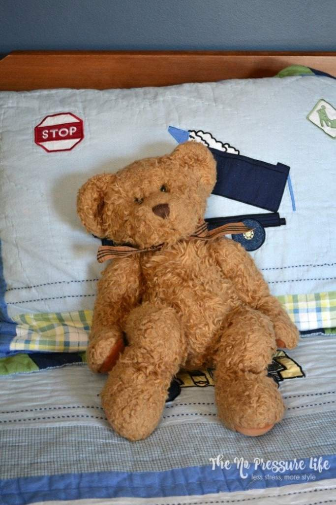 Boys bedroom with truck quilt and brown teddy bear