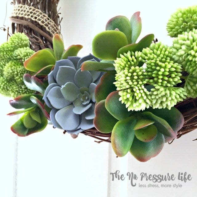 Learn how to make this simple succulent wreath in just 5 minutes! Quick and simple spring door decor.