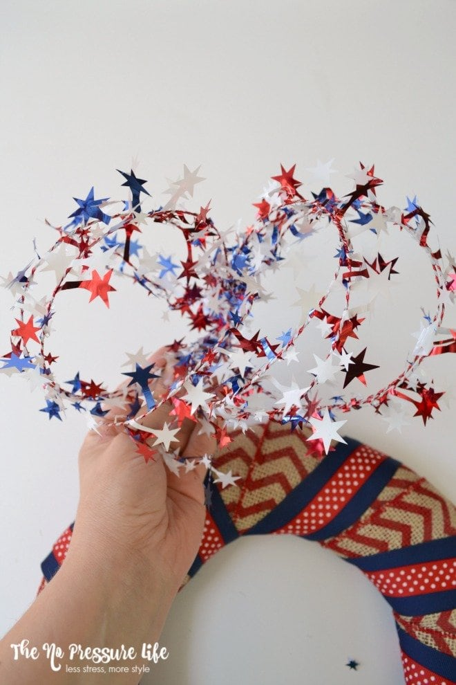 Adding red, white, and blue starts to a DIY patriotic wreath