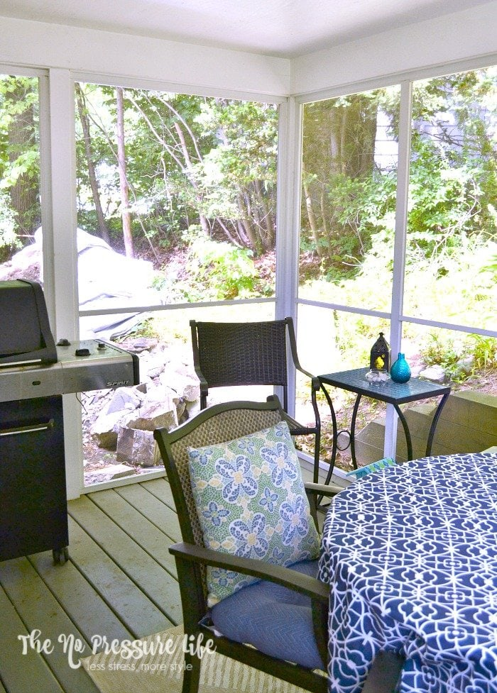 small screened in porch with a grill