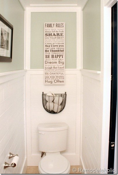 Hanging wire planter for toilet paper via Remodelaholic.