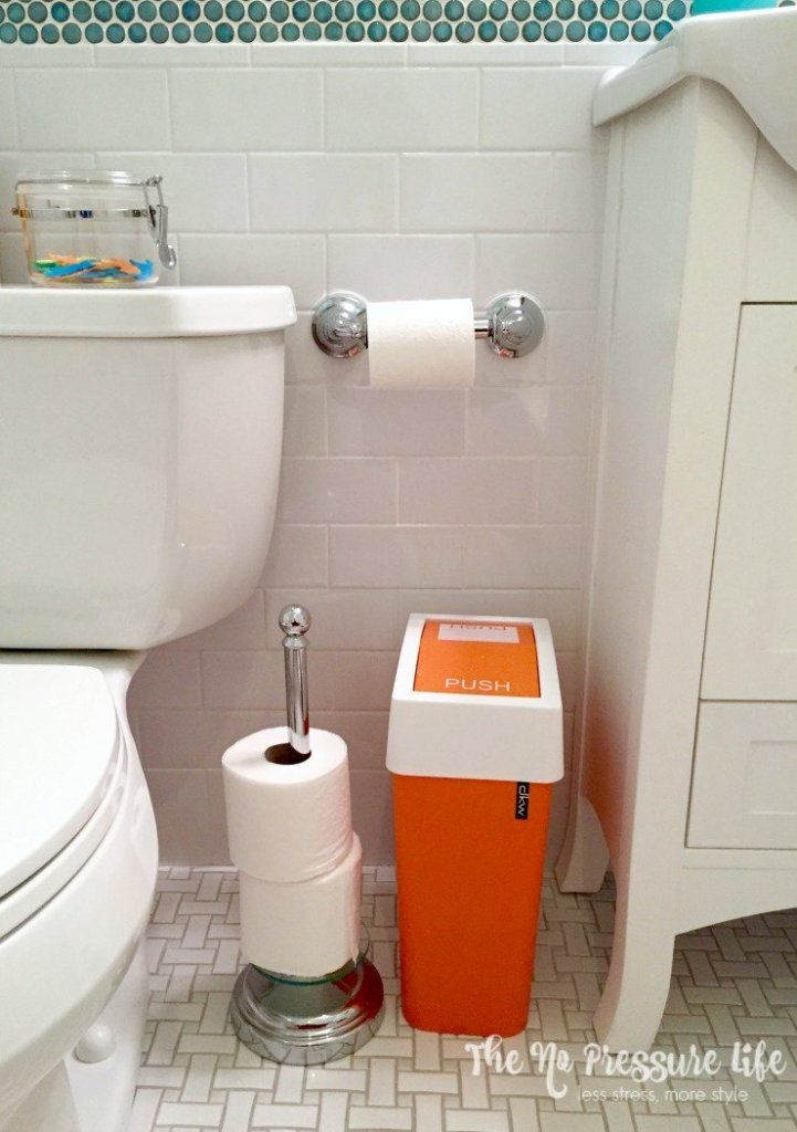 Organize extra toilet paper with a simple stand.