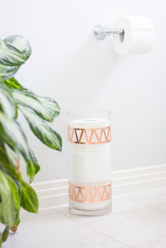 Glass vase turned toilet paper holder via Design Improvised